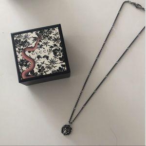 Gucci palladium lion pendant necklace